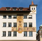 stock photo of mural  - Wall painting or mural of explorers on side of Chamber of Commerce in Nuremberg Germany - JPG