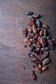 stock photo of cocoa beans  - Cocoa beans on slate background - JPG