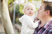 stock photo of daddy  - Adorable Little Girl with Her Daddy Portrait Outside - JPG