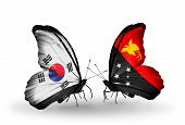 stock photo of papua new guinea  - Two butterflies with flags on wings as symbol of relations South Korea and Papua New Guinea - JPG