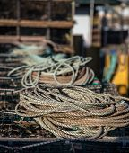 stock photo of coil  - coil of rope on top of a lobster trap in prince edward island - JPG