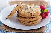 picture of chocolate-chip  - Chocolate chip cookies on a plate with fresh raspberries - JPG
