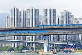 pic of hong kong bridge  - high speed train on bridge in hong kong downtown city at day - JPG