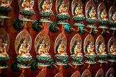 pic of gold tooth  - Rows of Beautiful intricately carved and colorfully painted identical sculptures inside the Buddha Tooth Relic Temple in Singapore - JPG