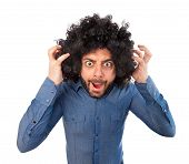 image of puffy  - Man with crazy expression and puffy hair on white background - JPG