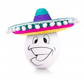 image of sombrero  - Concept white egg with happy face in a colorful sombrero isolated on white - JPG
