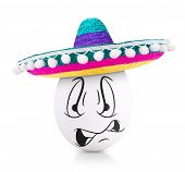 picture of egg whites  - Concept white egg with angry face in a sombrero isolated on white - JPG