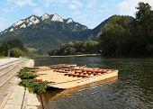 foto of pieniny  - Wood raft in autumn landscape - JPG