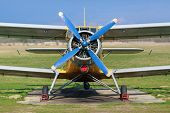 pic of biplane  - Biplane with blue blue propeller - JPG