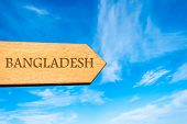 picture of bangladesh  - Wooden arrow sign pointing destination BANGLADESH against clear blue sky with copy space available - JPG