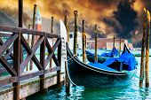 stock photo of gondola  - Gondola on the Grand Canal pier in Venice at sunset - JPG