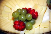 foto of cheese platter  - Delicious platter of cheese with fresh fruits - JPG
