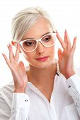 stock photo of shot glasses  - beautiful young woman in white glasses - JPG