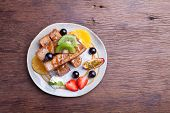 stock photo of french toast  - French toast with fresh fruit on a wood table - JPG