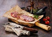 image of machete  - Raw fresh meat Steak Machete with salt and pepper on wooden background - JPG