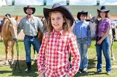 foto of horse girl  - cowboy girl closeup portrait on background of her family with horses - JPG