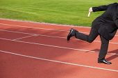 foto of race track  - Businessman running on race track - JPG