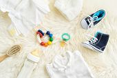 picture of teething baby  - Collection of items for babies shot from above - JPG
