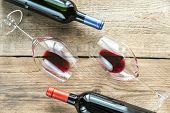 image of shiraz  - Glasses With Red Wine On The Wooden Table - JPG