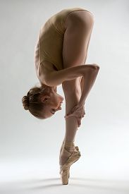 picture of lap dancing  - Fragile ballerina takes a deep slope forward - JPG