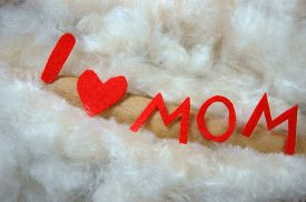 stock photo of i love you mom  - Happy mothers day i love you mom message idea from colorful fiber letter red heart on white cotton background abstract concept mother - JPG