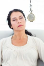 image of hypnotic  - Woman being hypnotized on white background - JPG