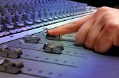 foto of recording studio  - recording studio mixing console with operator close up - JPG