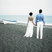 image of soulmate  - Romantic bride and groom are looking at the sea - JPG