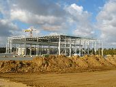 picture of commercial building  - Construction of a factory building in a commercial area - JPG