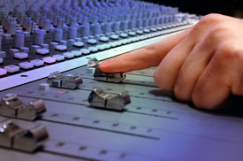 foto of recording studio  - recording studio mixing console with operator close up - JPG