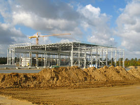 stock photo of commercial building  - Construction of a factory building in a commercial area - JPG