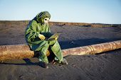 stock photo of scoria  - Environmental scientist working in the zone of ecological disaster - JPG