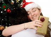 stock photo of christmas-present  - couple in love at christmas time over a white background - JPG