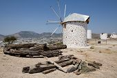 stock photo of gumbet  - 18th century traditional restored Turkish windmill overlooking Bodrum and Gumbet in the Aegean - JPG
