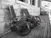 picture of antique wheelchair  - antique wheelchairs parked on the verandah at wolston house - JPG