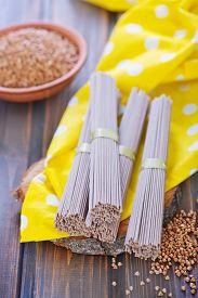 stock photo of buckwheat  - buckwheat noodles and buckwheat on a table - JPG