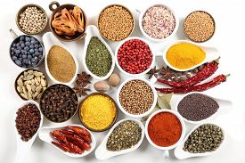 picture of flavor  - Flavorful colorful spices in ceramic and metal bowls on white background - JPG