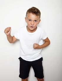 picture of hooligan  - Mockup of young hooligan showing some angry emotion on the white background - JPG