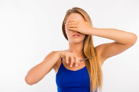 stock photo of split ends  - disappointed woman going to cut her split ends - JPG