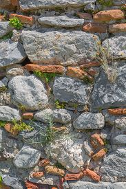stock photo of old stone fence  - Natural old stone wall texture brick ancient construction rock - JPG