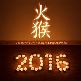 image of hieroglyphic  - Chinese new year greeting card with tea light candles in form of 2016 hieroglyph and lettering glowing in the night - JPG