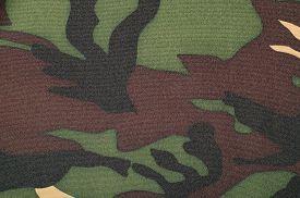 stock photo of khakis  - Brown khaki black military print as background - JPG