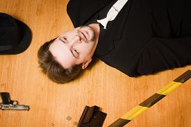 pic of corpses  - Corpse of business man lays on a floor - JPG