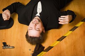 foto of corpses  - Corpse of business man lays on a floor - JPG