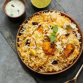 foto of raita  - Fish Biryani with Raita Basmati rice and Indian spices - JPG