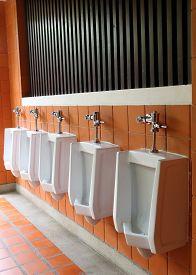 foto of urinate  - interior of white urinals in men bathroom toilet - JPG