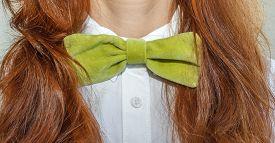 stock photo of bow tie hair  - model woman with green velvet bow - JPG