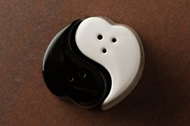 stock photo of yin  - salt and pepper shakers in yin yang form - JPG