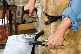 picture of blacksmith shop  - blacksmith at work in the repair shop in italy - JPG