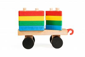 image of triangular pyramids  - Children wooden wagon on wheels with threaded rods which are rectangular and triangular blocks a side view isolated on white background - JPG